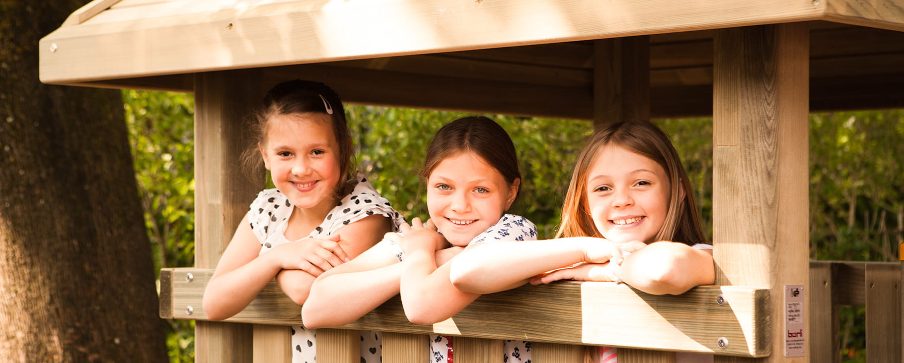 Three girls outdoors at SIS Swiss International School
