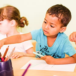 Boy colouring at SIS Swiss International School
