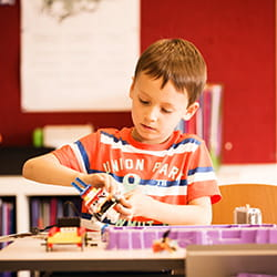Student playing with Lego at SIS Swiss International School